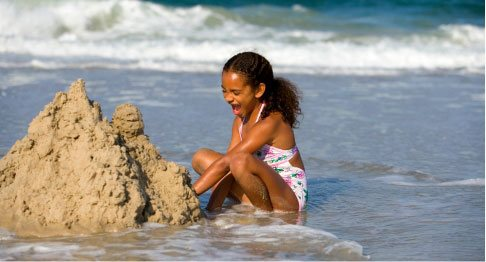 Kid making sand castle