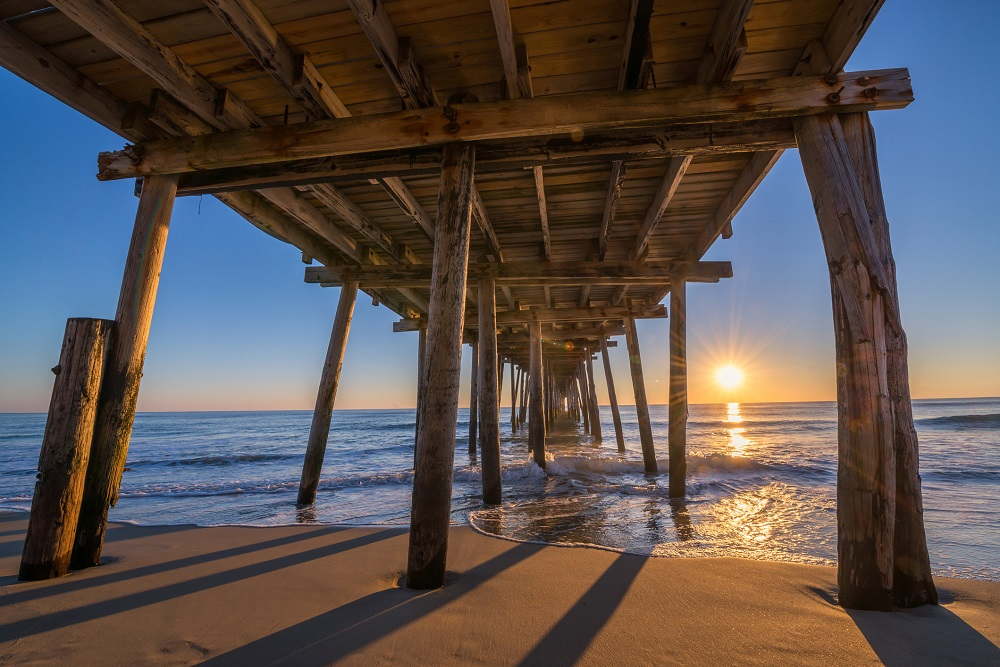 Underneath Nags Head Pier at sunrise