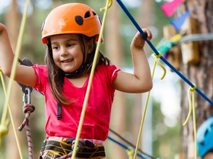 little girl having fun at corolla adventure park