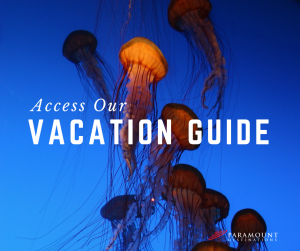 jellyfish in an aquarium text reads access our vacation guide