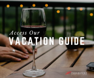 wine glass red wine outdoors text reads access our vacation guide