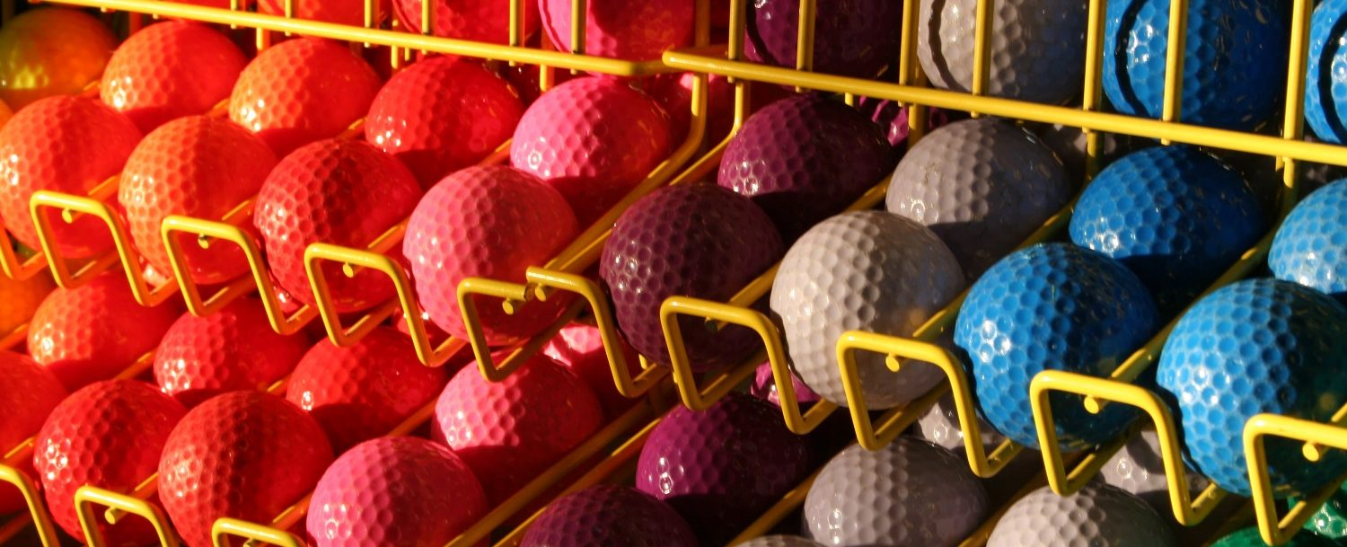 Colorful choice of golf balls for a round of mini golf