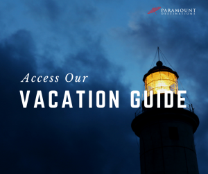 outer banks lighthouse beam text reads access our vacation guide