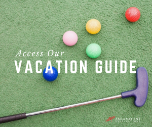 golf putter, golf balls, colorful on the green, text reads access our vacation guide