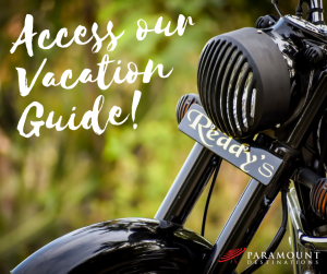 close up shot of motorcycle text reads access our vacation guide