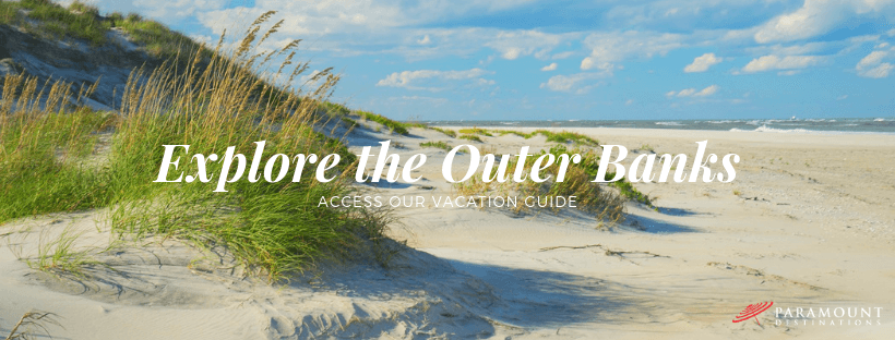 Sand dunes and grass swaying in the breeze on an outer banks beach