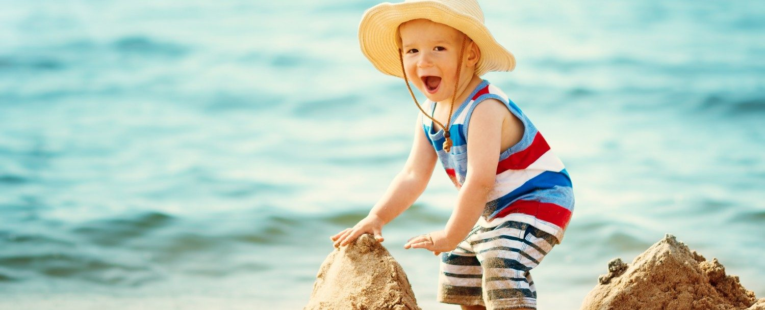 Child at the Beach Playing in Sand