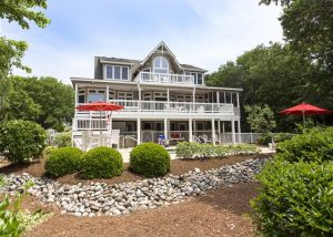 Once you book flights at the closest airport to the Outer Banks, book your stay in Ray's the Roof.
