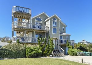 outside of Crabby Mermaid vacation rental with winding stairs