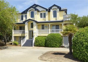 exterior of yellow and blue vacation rental