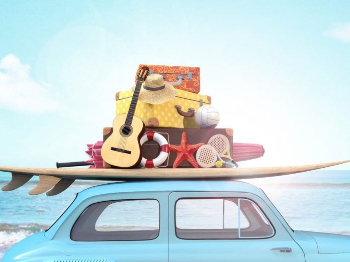 beach vacation, car with guitar, hat, starfish, surfboard, in front of ocean