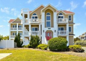 outer banks pet friendly vacation rental exterior, blue sky, grass
