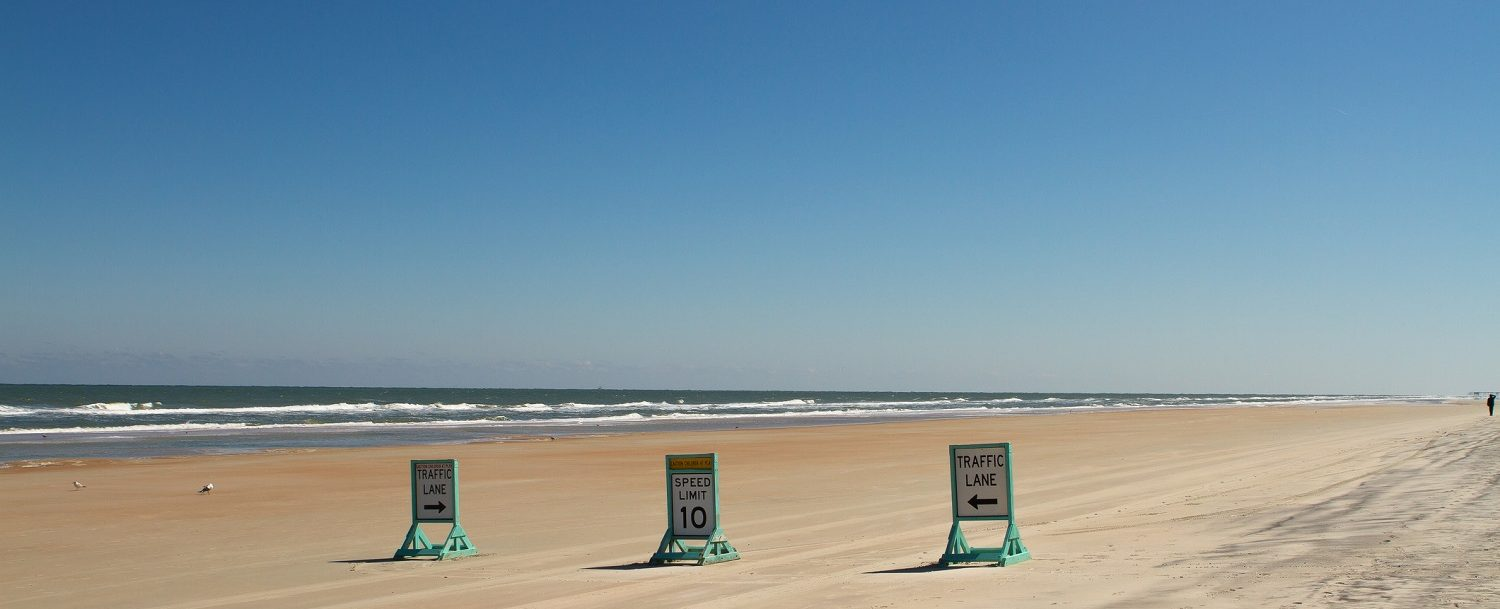 driving on beach outer banks, traffic signs