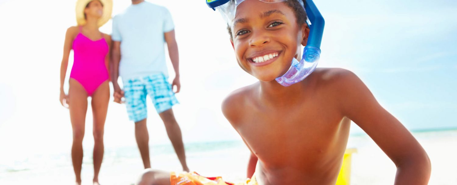 family on the beach with sand toys, family activities on outer banks