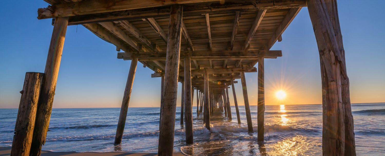 sunrise, nags head pier, outer banks vs virginia beach