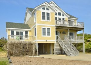 yellow vacation rental exterior on outer banks