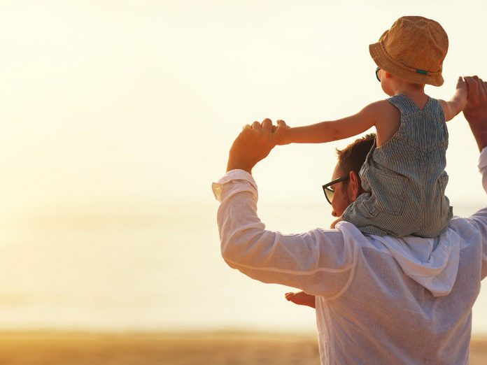 activities ideal for an unforgettable father's day, father and son on beach, outer banks